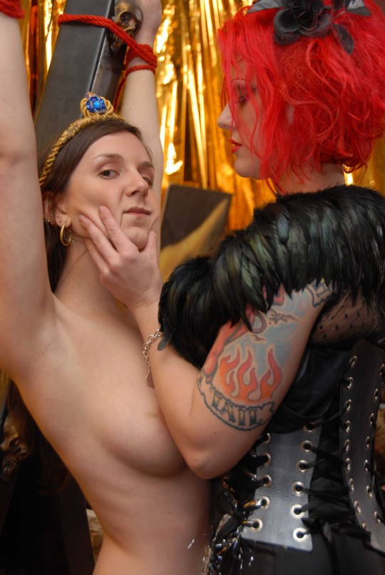 The Queen of Chaos (Goddess Soma) tortures Venus, naked on the X.  Want to see more?  Join the bloggamy...