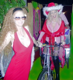 Bicycling the rickshaw filled with gifts for naughty people, led by red-haired reindeer Annie Body. Photo: Kim