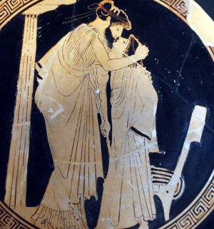 An Ephebe Kisses a Man in this Tondo from an Attic kylix, 5th c. BCE by the Briseis painter, from the Louvre