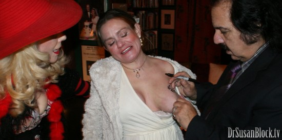 Ron Jeremy signs Asher's boob. Photo: L'Erotique