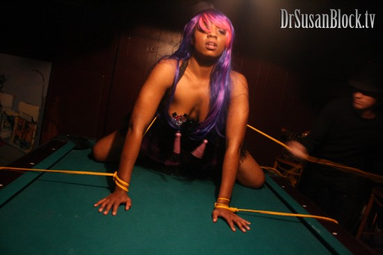 Dark Phoenix ties up Trixie on the pool table. Photo: Abe