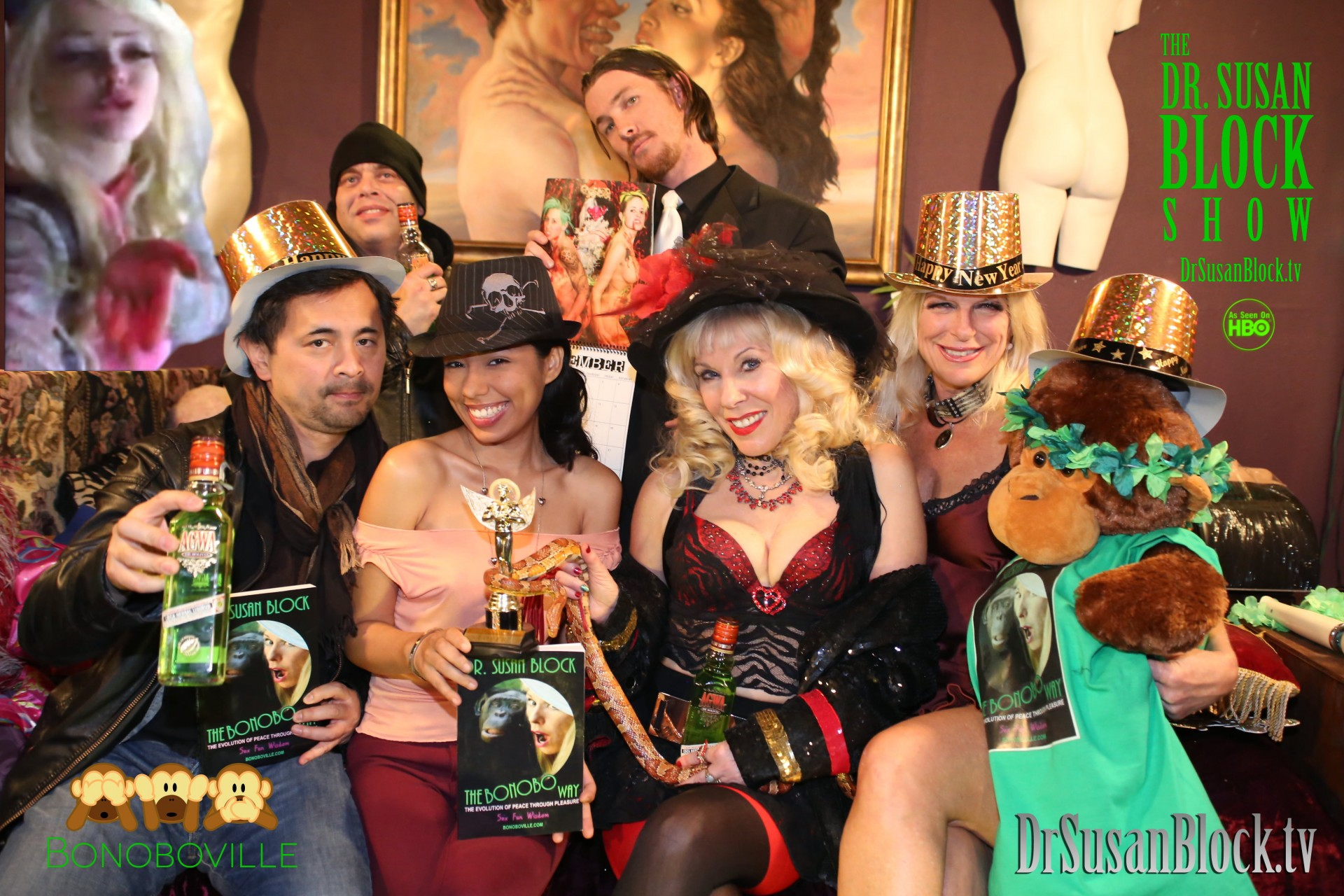 "The DrSuzy.Tv Awards: Amor Hilton, Anthony Winn, Jack Nice, Goddess Maya with ""SUZY"" Award, and The Bonobo Way, Dr. Susan Block, Dark Phoenix with Unlicensed Professionals' ""Buttload O' Months"" Calender, Chelsea Demoiselle with Bonzo in Bonobo Designs T-shirt. Photo: BW"