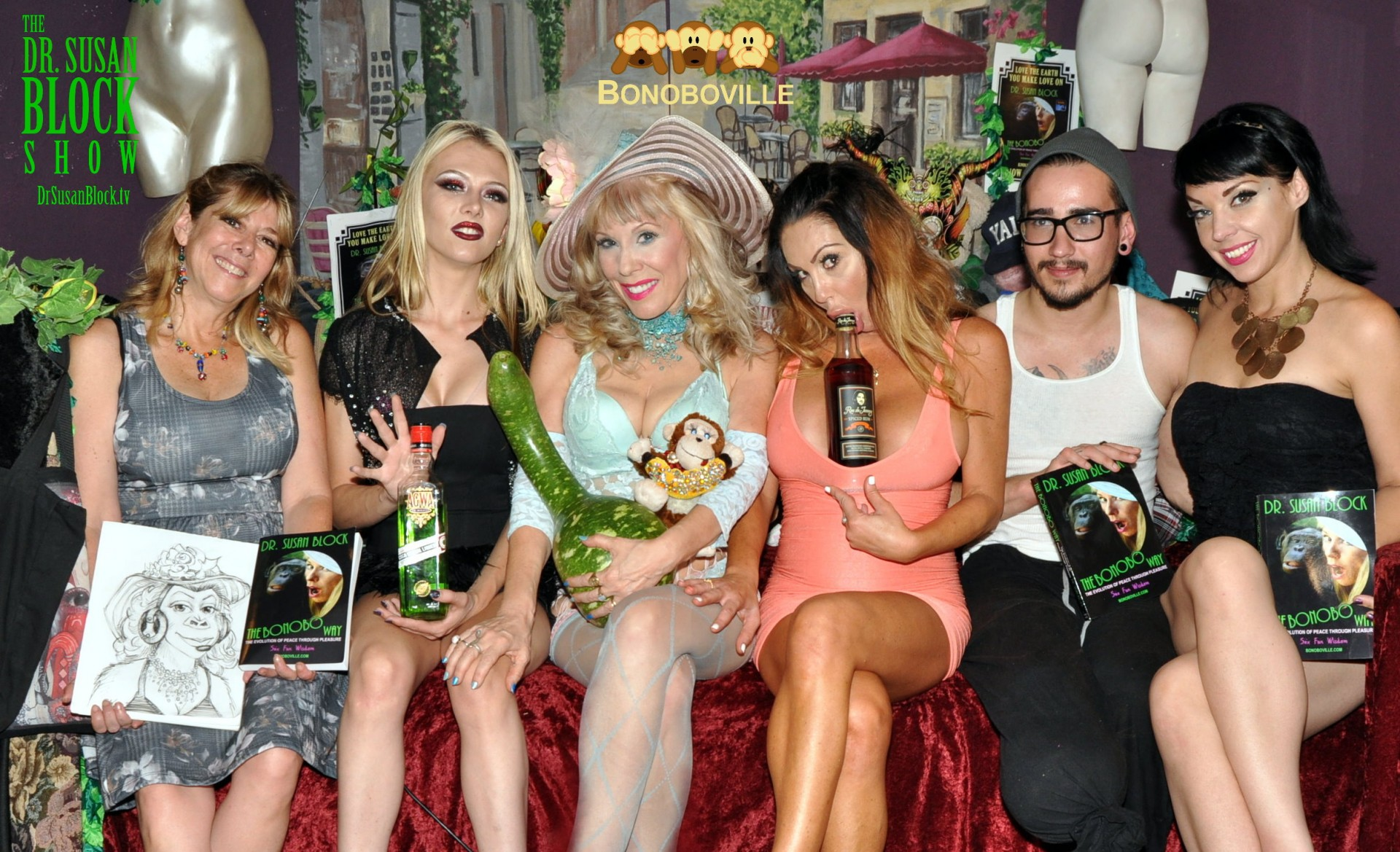 "Helane with her ""Bonobo Suzy"" drawing & The Bonobo Way, Jeanie Marie with Agwa Coca Leaf Liqueur, Dr. Susan Block with gourd, Dayton Rains with Ron de Jeremy Rum, James Dickson & Elizabeth Aston with The Bonobo Way. Photo: RingoShotYou"