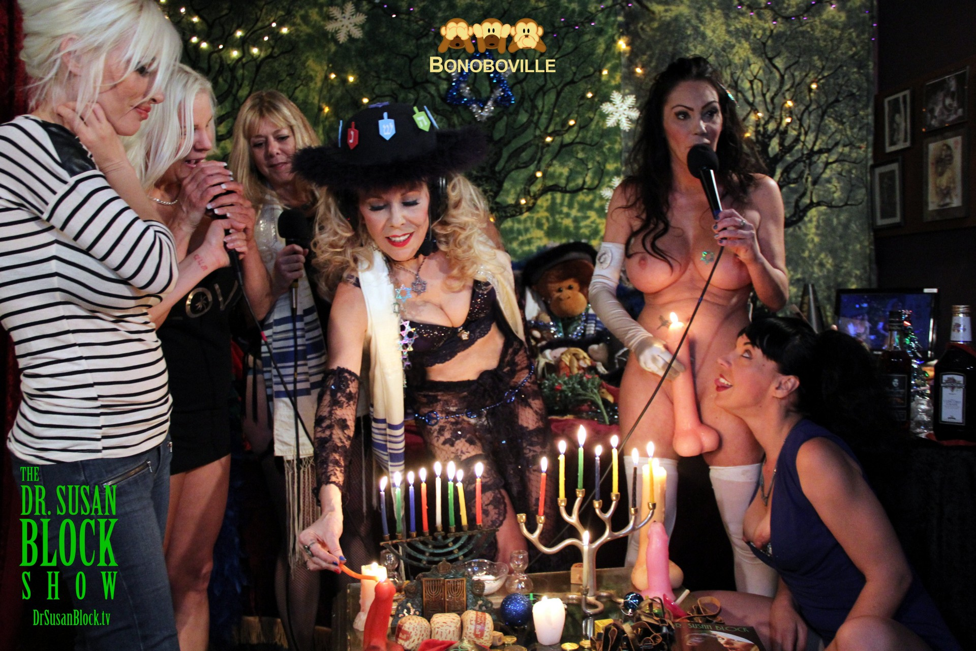 Lighting the Hanukkah Menorah, and some other types of candles, in Bonoboville. Photo: Ono Bo