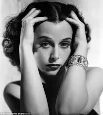 Brainy Beauty Hedi Lamarr runs her fingers through her hair.