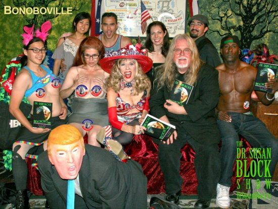 Trump on his knees, spanked by The Bonobo Way, flanked by U.S. Presidential Candidates Mistress Tara & Mr. Vallance on DrSuzy.Tv. Photo: L'Erotique
