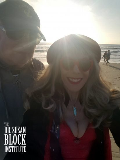 "Connecting with angels (and the couple behind us) through my ""angel aura quartz"" as my Valentine and I take a ""walk on the beach."" #Selfie"