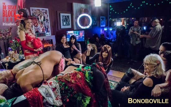 Mistress Cyan flogs a Trifecta of beautiful Bonoboville buns. Photo: Jux Lii