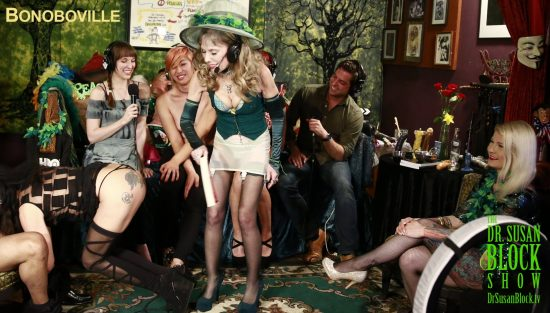 Book-Spanking Jacquie with The Smart Girl's Guide to Polyamory as she takes Bonoboville Communion off of Todd's 10-inch Irish shillelagh. Photo: Tim Nguyen