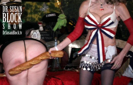 Dr. Suzy spanks Rhiannon Aarons with a French baguette on Bastille Day. Photo: Ben Volo