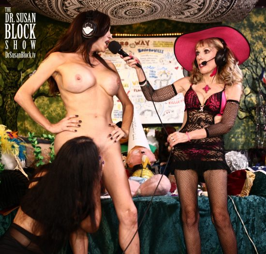Jaquie Blu takes a very worshipful Bonoboville Communion from Altar Girl Kourtney van Wales. Photo: Mickey Kross