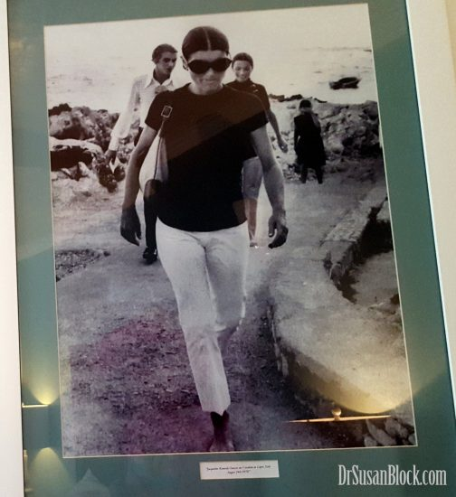 Jackie O walking ponderously through Capri, Italy.