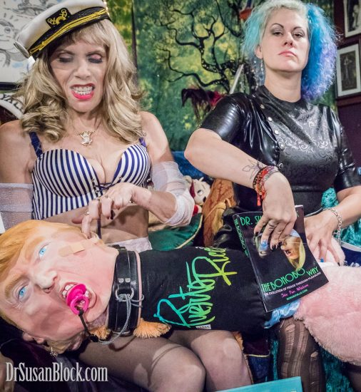 Goddess Soma Snakeoil arrives just in time to help me give tRUMP a Bonobo Way book-spanking. Photo: Jux Lii