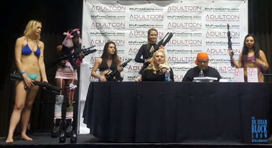 Pornstars Wielding Guns (I Hope They're Fake!) Preceded Me Onstage at Adultcon. Photo: Author