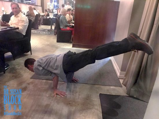 Lou Corona does a handstand for us right in the middle of the restaurant. Photo: Be*Live