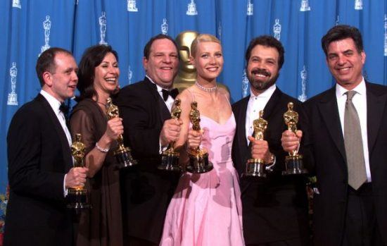 "LOS ANGELES, CALIFORNIA - MARCH 21 : ""Shakespeare in Love' Best Actress winner Gwyneth Paltrow (center) is joined by Harvey Weinstein (center lett) , David Parfitt (left), Donna Gigliotti,Edward Zwick and Marc Norman (right) backstage as they celebrated their win of Best Picture at the 1999 Academy Awards in Hollywood, California, March 21, 1999.(Photo by Bob Riha, Jr./Getty Images)"