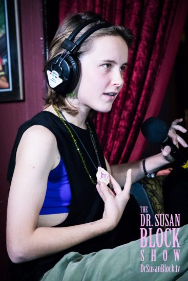 Shelby shows off her Vulva pendant. Photo: Jux Lii