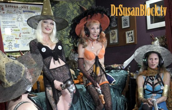 Gypsy & Dr. Suzy fly through BOOnoBOOville on their Magic Dildonic Vibrating Brooms as Madame Margherite brandishes a dildonic sword. Photo: Franz Salvatierra