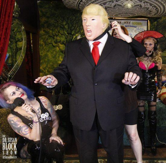 Mistress Tara collars the Trumpus on DrSuzy.Tv. Photo: Clemmy Cockatoo