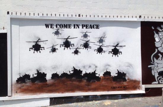 """We Come In Peace."" Anti-War Street Art by Plastic Jesus"