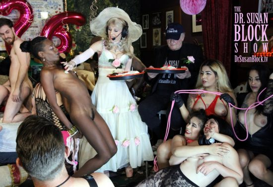 I apply icing to Mpenzie's nipples as Bryan checks us out, mid-doggie, and the GasMaskGirls get it on. Photo: Slick Rick
