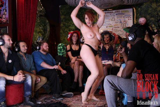 Mistress Kara mesmerizes the Womb Room with her Striptease. Photo: Slick Rick