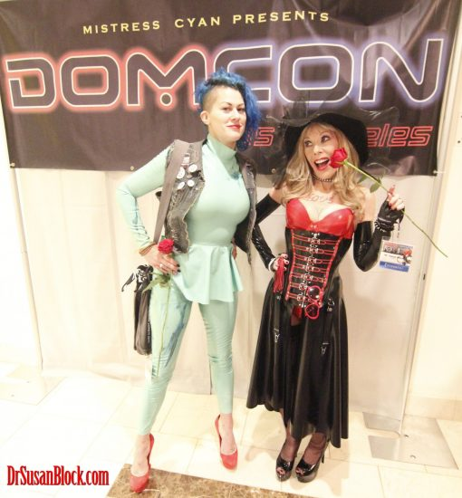 In Demask Latex, with Goddess Soma Snakeoil at Mistress Cyan's DomCon 2018. Photo: Abe Bonobo