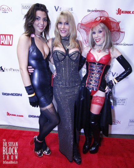 "In Demask Latex with ""Little"" Phoenix & Goddess Phoenix on the Red Carpet, DomCon LA 2018. Photo: Abe Bonobo"