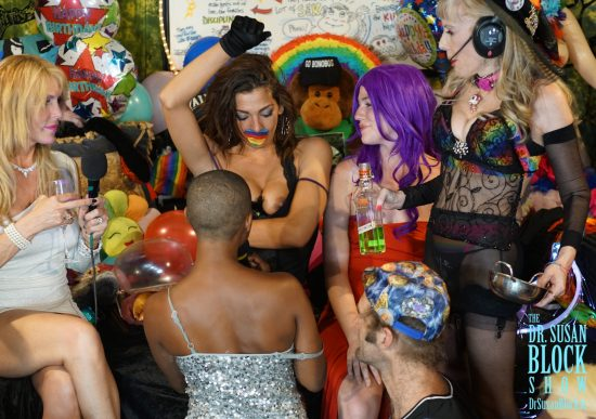 Phoenix rainbow-pasty-gags herself as she unveils her Altar for Daniele. Photo: Capture It