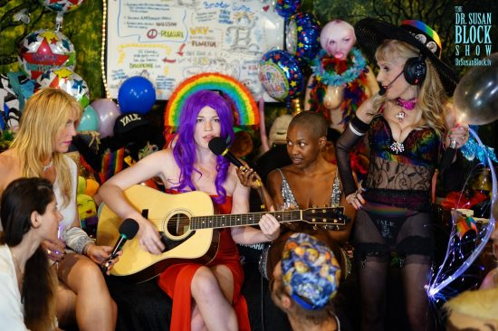 "Jezebel Sweet sings ""No Angel,"" her purple hair halo'ed by a rainbow. Photo: Capture It"