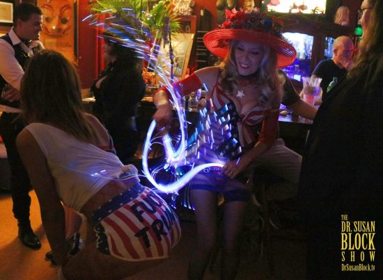 Goddess Phoenix's neon whip creates fireworks as it flies through the dark air. Photo: Axel Carnigan