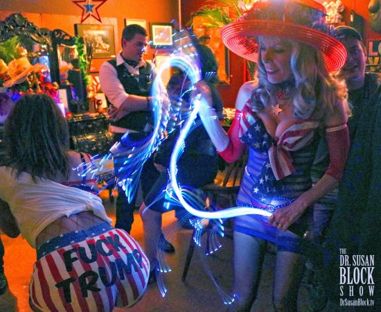 "Spanking Phoenix's ""Fuck Trump"" behind with the ""Rockets Red Glare"" of Goddess Phoenix's lightning whip. Photo: Axel Carnigan"