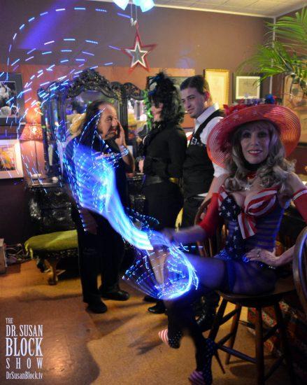 "Ronny & Rosie + Pretty Boy ""hiding"" behind the Neon Veil of Goddess Phoenix's Whip in the Speakeasy. Photo: Hugo Flores"