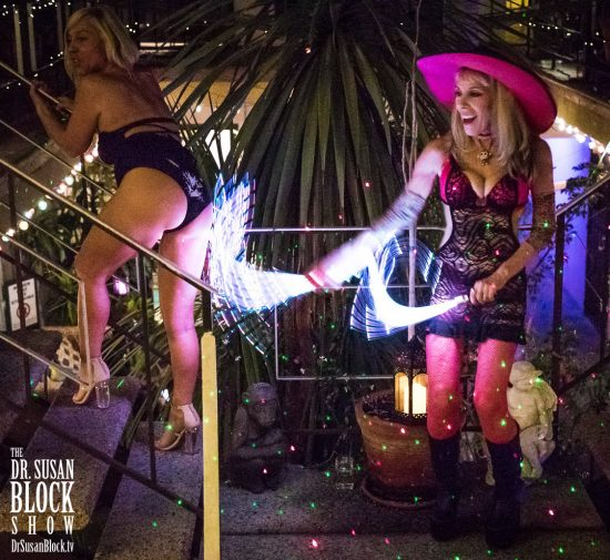 Spanking Brigitte's fine pussy-pantied ass with Goddess Phoenix's neon whip in the Garden of Bonoboville. Photo: Jux Lii
