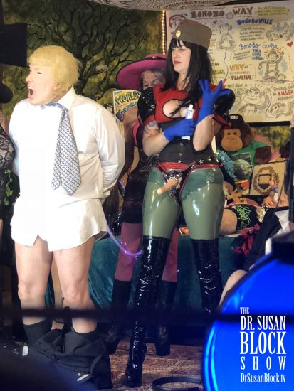 Maria Buttina prepares to interrogate tRUMP's rump. Photo: Clemmy Cockatoo