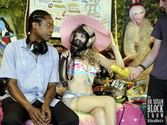 Trying vainly to converse with Lamar in the GasMask while Luzer is inexplicably handing me the Buddha Dildo. Photo: Jason