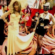 Dr. Suzy in Catalyst Latex Bridal Gown with Gypsy Bonobo at the DomCon 2017 Kitty Parade in front of the DomCon booth.  Photo: Abe