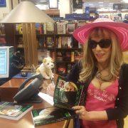 Pretending to sign books as I pose