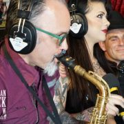 Professor Oni blows his horn as Lillith listens & Cowboy Jack Friday relaxes