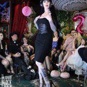 Mistress Porcelain Midnight models her designer dress, waist-cincher & Louboutins
