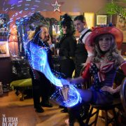 "Ronny & Rosie + Pretty Boy ""hiding"" behind the Neon Veil of Goddess Phoenix's Whip in the Speakeasy. Photo: Hugo Flores"