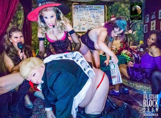 Bday Babe Rhiannon spanks Trump's Rump with the Forbes that Stormy spanked him with. Photo: Jux Lii