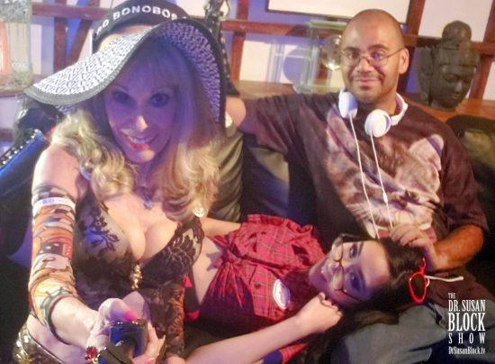 Eva Yi lying lazily in Michael Sullivan's lap of luxury in the Bonoboville Green Room. Photo: Selfie
