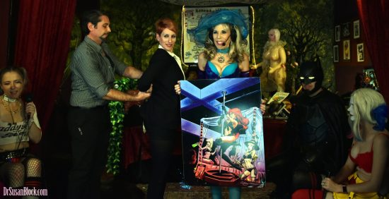 "Showing off ""Stripperella on DrSuzy.Tv"" by Anthony Lee Winn (co-creator of Stripperella with Stan Lee) as Ironman/Tony Stark ties up Pepper Potts. Photo: Anastasia"