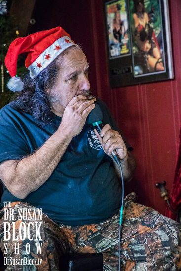 "Ron plays ""Santa Baby"" on harmonica. Photo: Jux Lii"