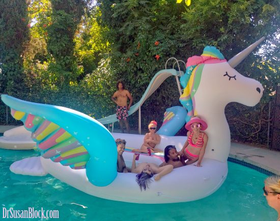 Riding the Unicorn with naked FemDoms and friends in Goddess Phoenix's pool. Photo: Max